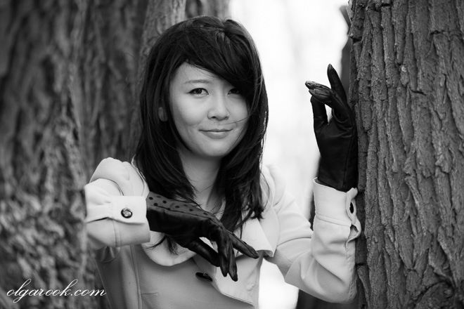 black and white outdoor portrait of an elegantly dressed young woman