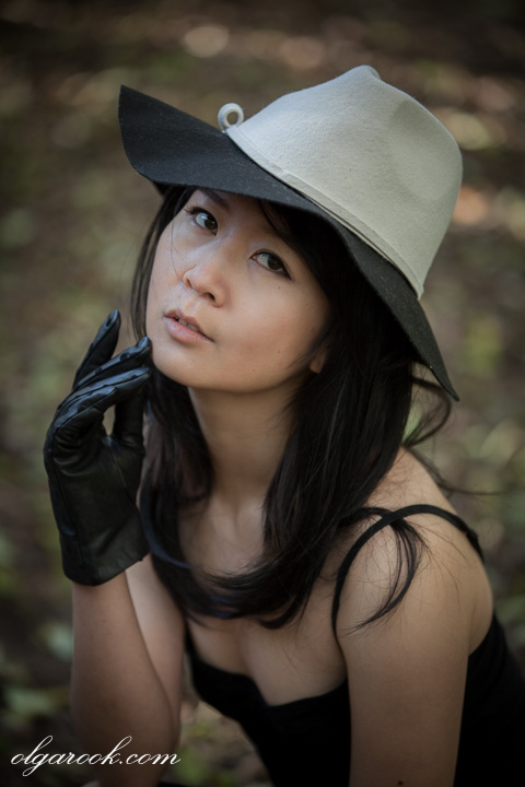 Photo of a young woman wearing gloves and a hat