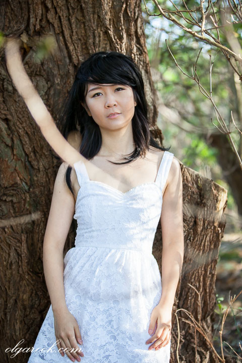 Portrait of an Asian girl in a forest.