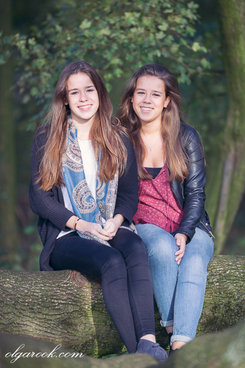 Photo of two laughing teenage girls in a tree