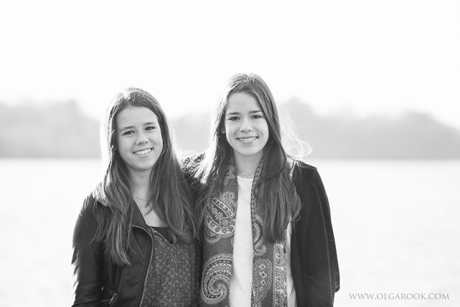 black and white portrait of two sisters at a lake