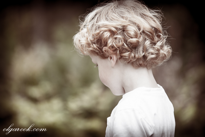 Retro-style photo of a little boy with lovely blond curls