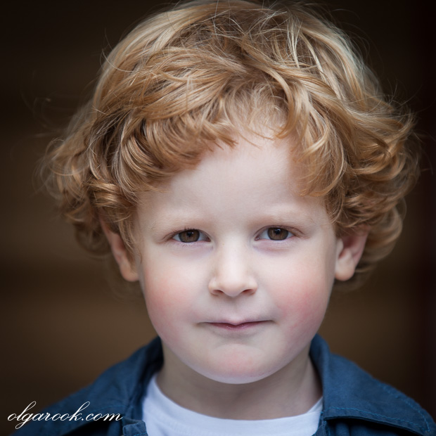 Artistic portrait of a cherub-like curly little boy.