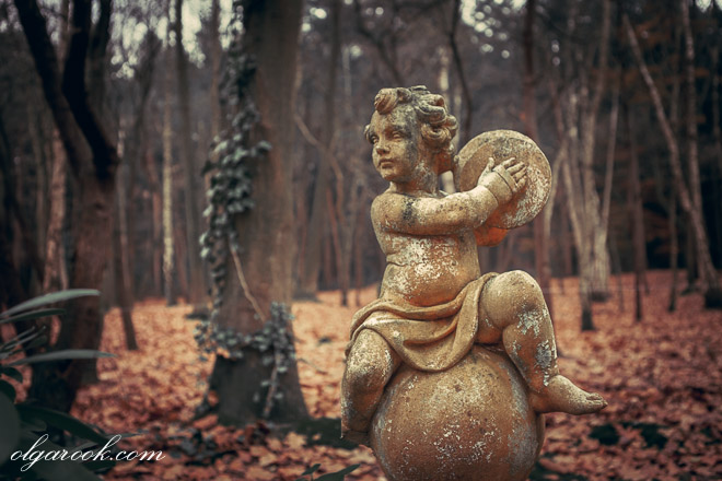 photo of a garden sculpture in a forest