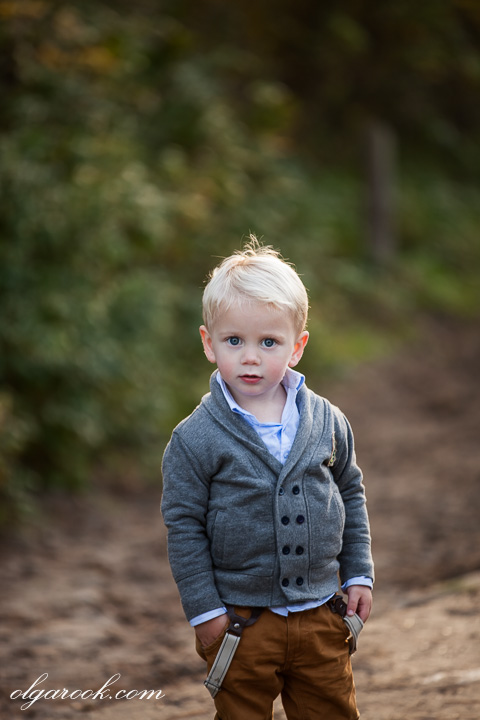 portrait of a small blond boy with an independent expression