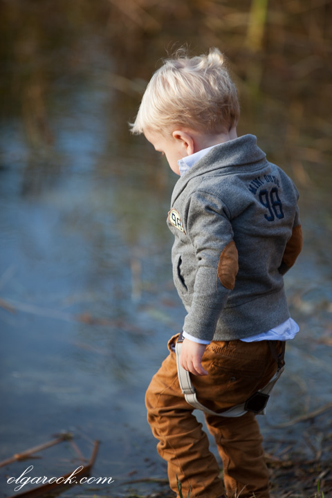 photo of a little boy playing close to the water