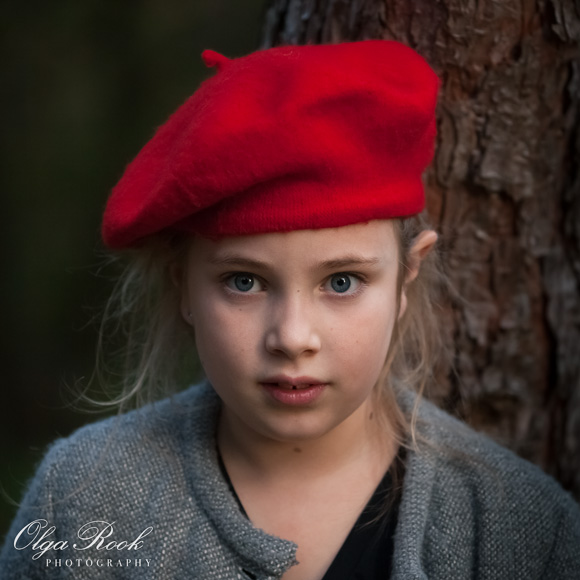Portrait of a girl wearing a red beret