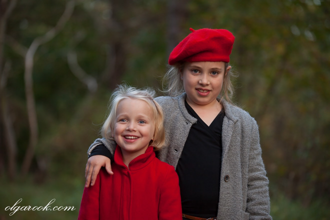portrait of two little girls in a forest at dusk