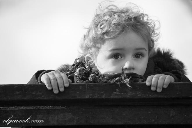 Nostalgic portrait of a little boy in a park