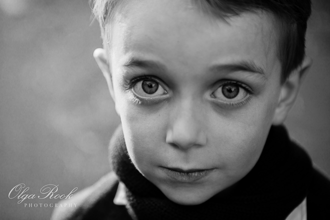 Black and white portrait of a boy with big eyes.