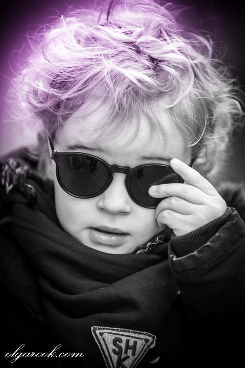 portrait of a tough looking little boy wearing sun glasses