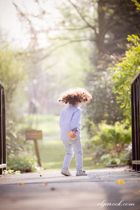portrait of a running little girl with long curls