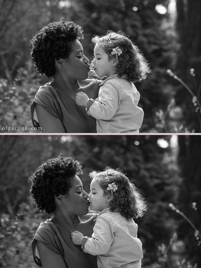 An emotional and pure moment when a little child gives a kiss to her mother.