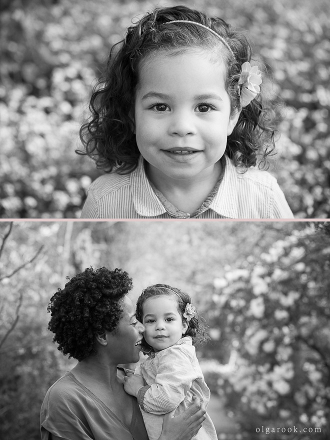 Classic and joyful portrait of a little girl and her mother in a spring park