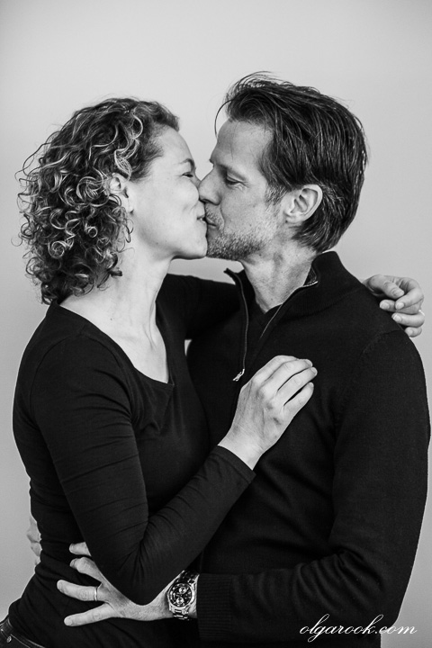 Black and white portrait of a kissing couple
