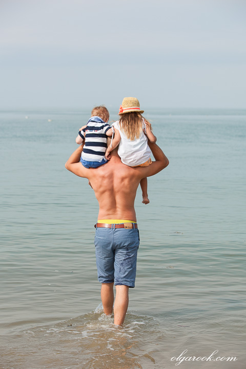 Portrait of a father with his little children on the beach