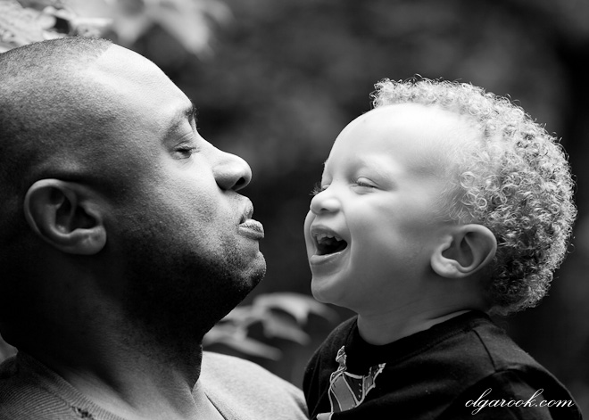 Natural and emotional portrait showing a connection between a father and his little son