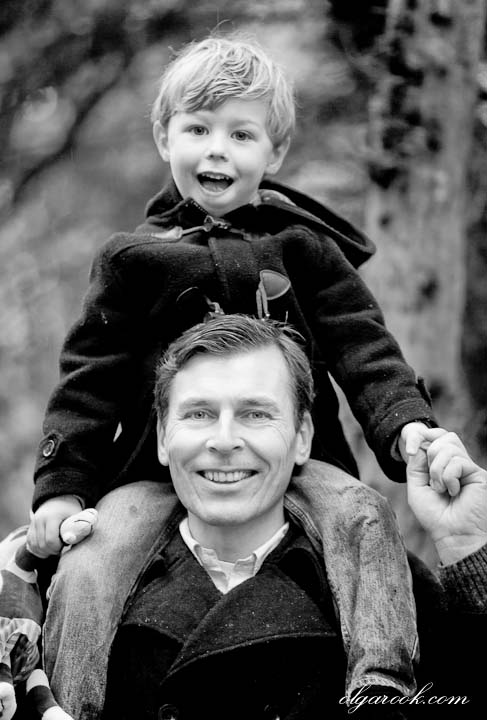 Emotional and natural portrait of a happy father and son together.