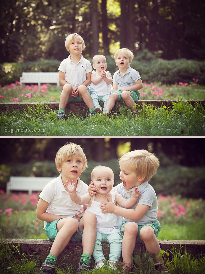 Portraits of three little children in a park listening to a story with great interest.