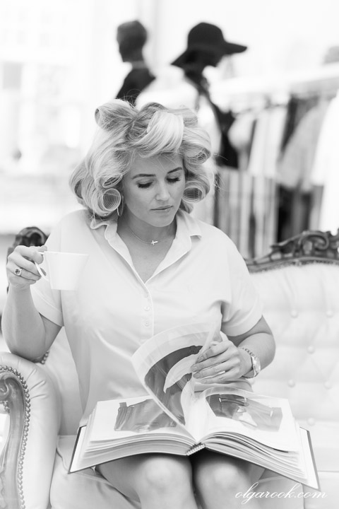 photo of a woman reading a fashion magazine with a cup of coffee