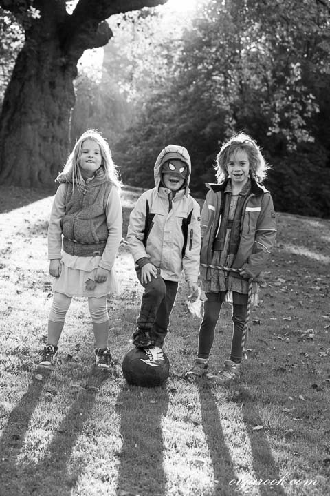 Photo of three children in a park.