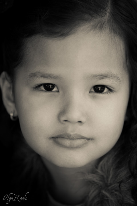 Classic fine art photo portrait of a little girl with dark eyes