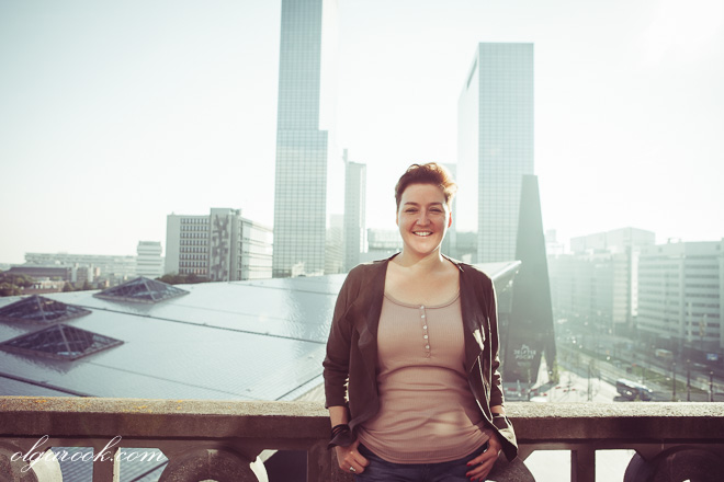 Business portrait of a laughing young lady with a busy city as a background