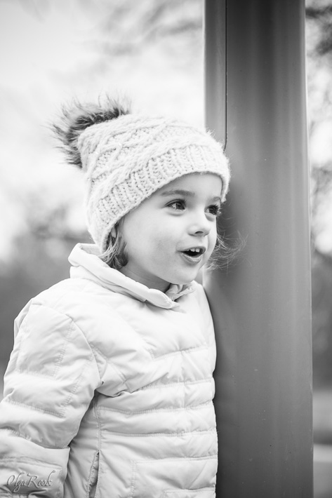 photo of a little girl wearing winter clothes