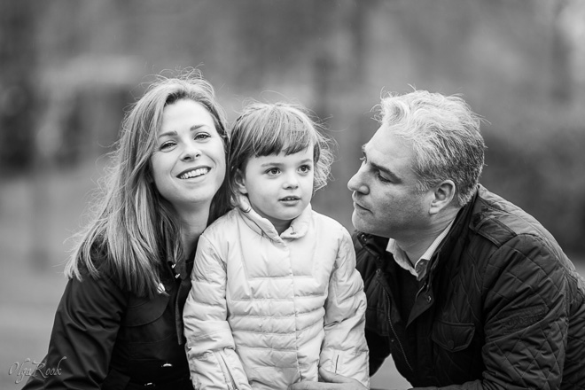 Portrait of a family: a little girl between her parents