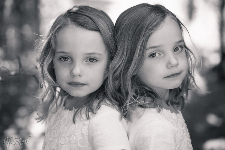 Portrait of little twin girls in a park