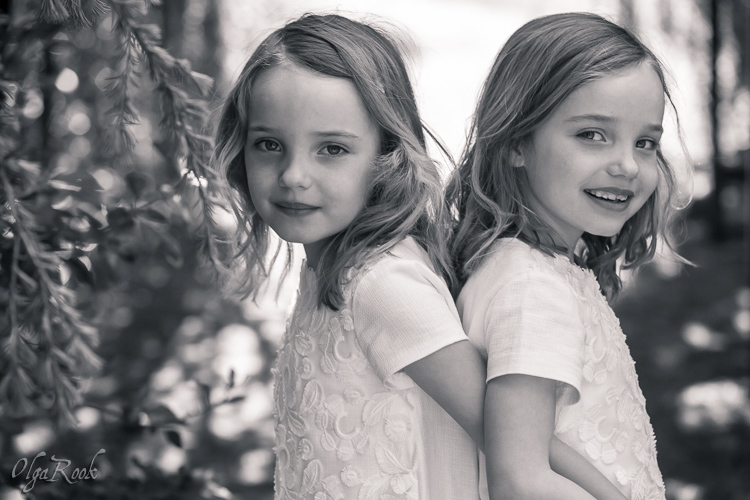 Photo of little twin sisters in a park