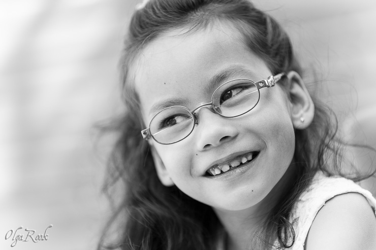 photo of a little girl wearing glasses