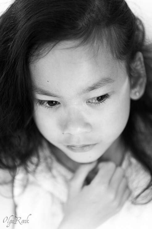 nostalgic portrait of a little girl with long eyelashes.