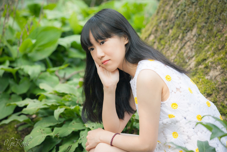 fashion style portrait of a Chinese girl in a park