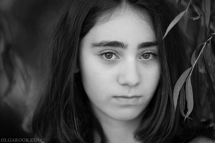 classic and romantic black and white portrait of a young girl with bright eyes