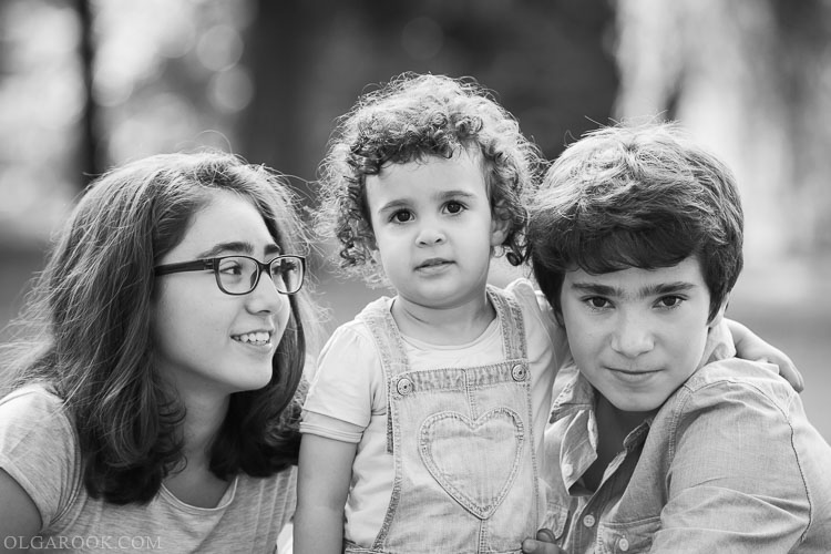 portrait of siblings: elder brother and sister with their two-year old sister