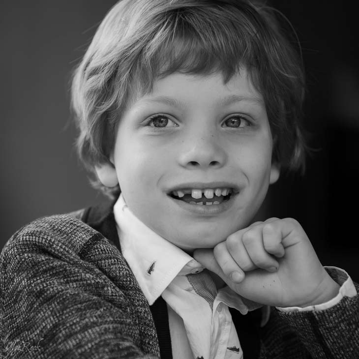 portrait of a laughing little boy