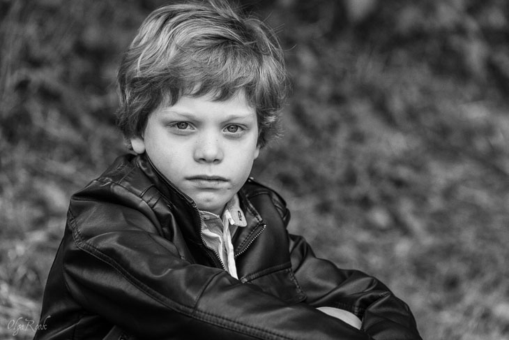 moody portrait of a little boy with a dramatic look