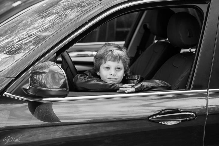 photo of a little boy in a car