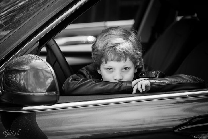 photo of a boy in a car