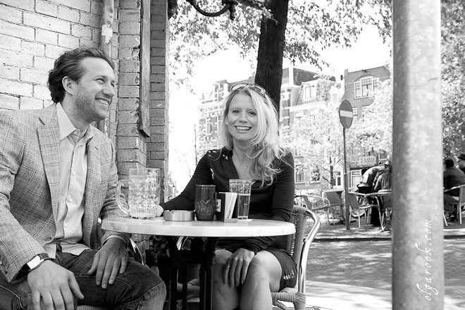 Photo of a couple sitting outside at a café in the center of Amsterdam.