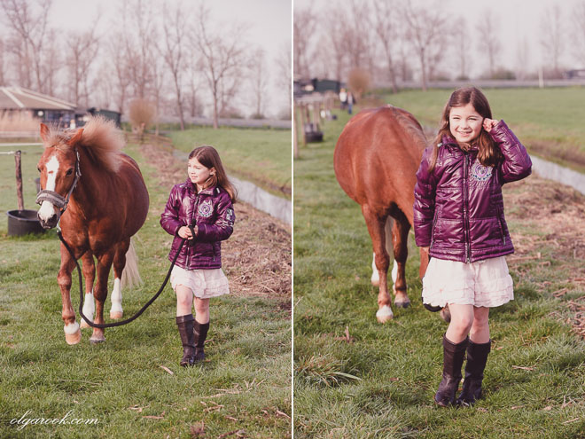 Photos of a little girl walking with her pony in a field behind the riding school.