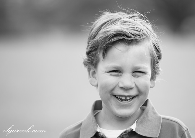 Portrait of a laughing boy with a cute smile