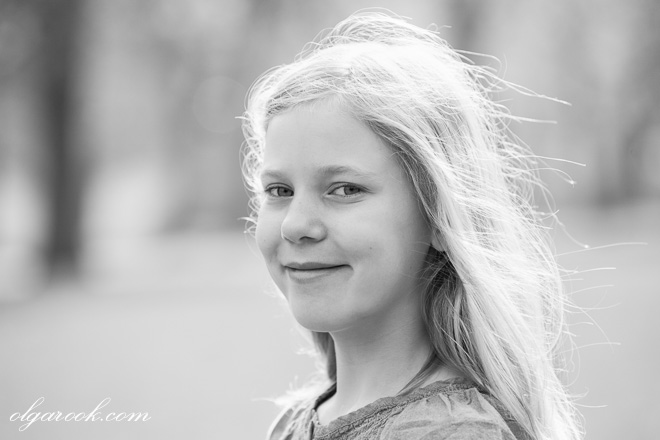 Black and white portrait of a blond girl.
