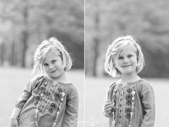 portretten van een klein meisje: ze geniet duidelijk van het feit dat ze geportretteerd wordt!