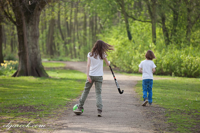 photo of two children walking in a park