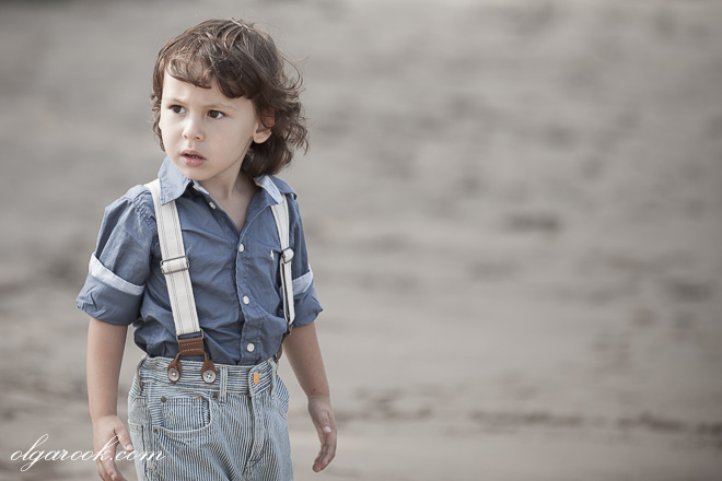 Romantic portrait of a little boy in front of a river.