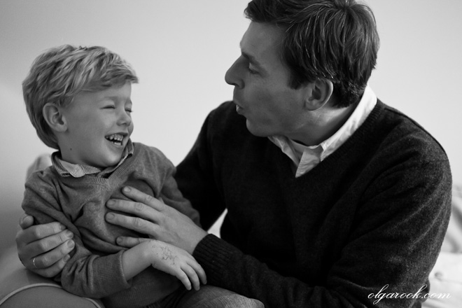 nostalgic portrait of a father and son playing and laughing