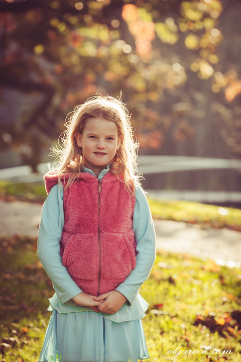 Portrait of a little girl in an autumn park