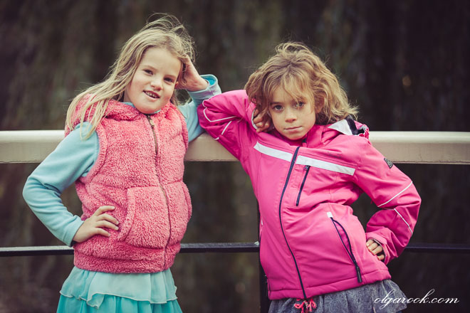 Photo of two little girls posing like photo models